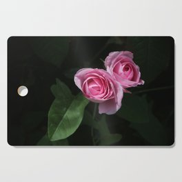 Pink and Dark Green Roses on Black Cutting Board