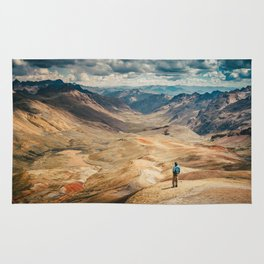 Man front of the mountain Rug