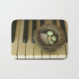 Chocolate Eggs in a Birds Nest on a Vintage Piano. Bath Mat