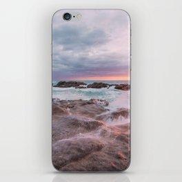 Rocky beach at sunset iPhone Skin