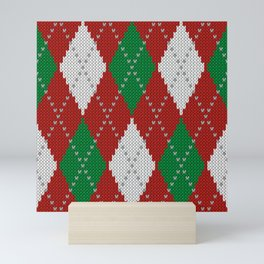 Knitted argyle Christmas sweater pattern on red Mini Art Print