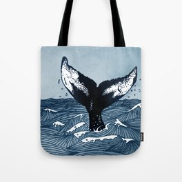 Hump Back Whale tail breaking the surface of stormy waves at sea Tote Bag