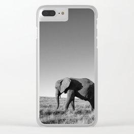 Lone female elephant walking along African savanna Clear iPhone Case
