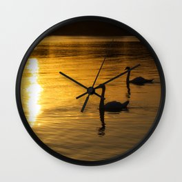 Swans at sunset. Wall Clock