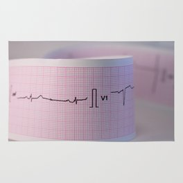 Approach and defocus an electrocardiogram strip. Record of the electrical activity of the heart. Rug
