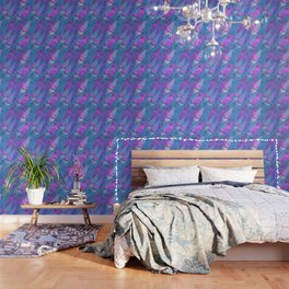 The colorful feathers on blue background . Wallpaper