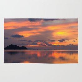 Orange sunset reflection Rug