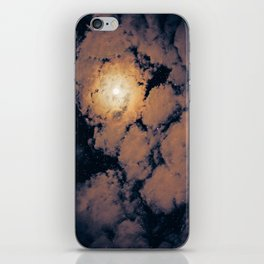 Full moon through purple clouds iPhone Skin