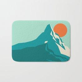 As the sun rises over the peak Bath Mat