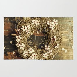 Easter egg wreath on a wooden background Rug