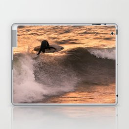Surfer grabs air on wave at sunset Laptop & iPad Skin