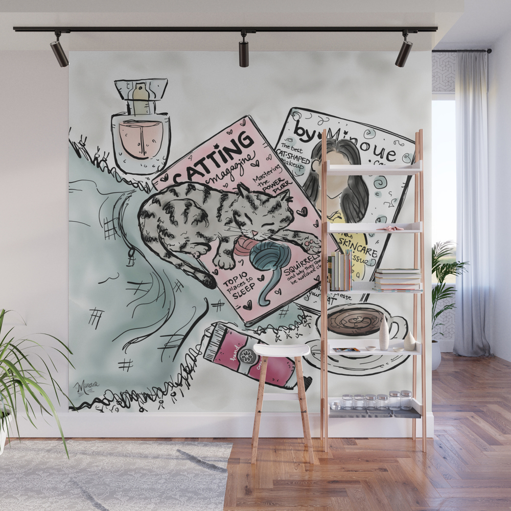 Kitty Sleeping On Magazines Wall Mural by Byminoue WMP7987952