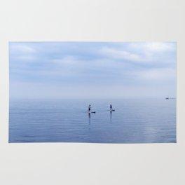 Couple Paddleboarding on Lake Ontario Rug