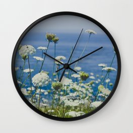 Flowers by the Beautiful Blue Sea Wall Clock