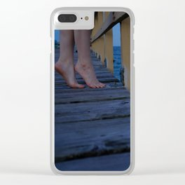 Woman standing on the edge of a pier Clear iPhone Case