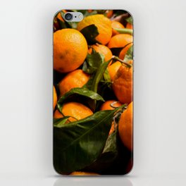 A Photo of Oranges with Green Stems iPhone Skin