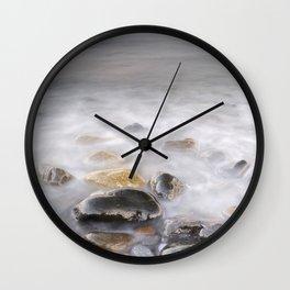 Shiny rocks at sunset Wall Clock