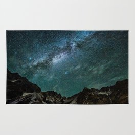 Milky Way over mountain range Rug