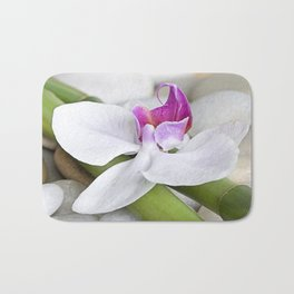 white Orchid flower  and green Bamboo still life Bath Mat
