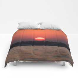 Really red sun Comforters