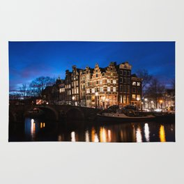 Amsterdam canal houses at night Rug