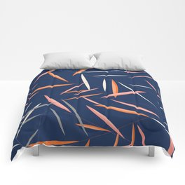 Colored leaves in a dark blue background Comforters