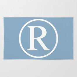 Registered Trademark Sign on placid blue background Rug