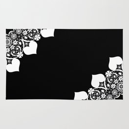 Retro . White lace on a black background . Rug