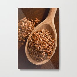 Brown linseeds portion on wooden spoon Metal Print
