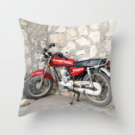 Motorbike red parked by the cement wall Throw Pillow
