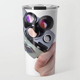 Retro mechanical movie camera in hand of  operator Travel Mug