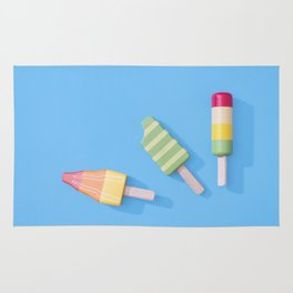 Three Ice Lollies on Blue Rug