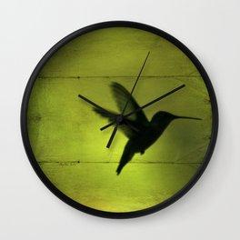 Neon Green Hummingbird behind the blinds Wall Clock