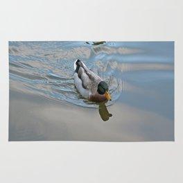 Mallard duck swimming in a turquoise lake 1 Rug