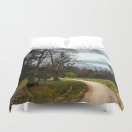 road in a forest Duvet Cover