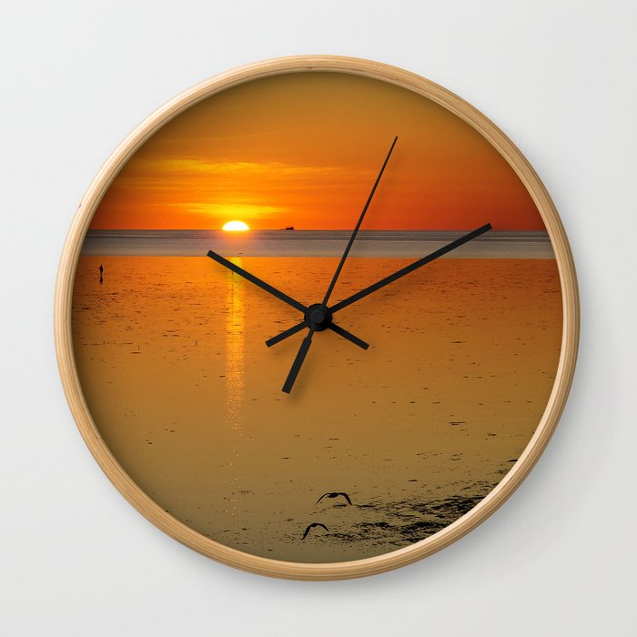Sunrise over the bay Wall Clock