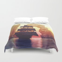 A pirate ship off an island at a sunset Duvet Cover