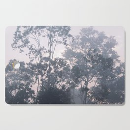 The mysteries of the morning mist Cutting Board