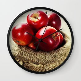 Burlap sack with apples on a wooden table Wall Clock