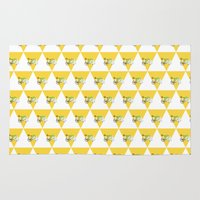 cycling Area & Throw Rugs featuring Cycling Polar Bear Triangle by Heather Doucette