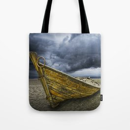 Beached Boat with Storm Brewing Tote Bag