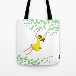 Happy times. Little girl in bright yellow dress on the tree swing. Tote Bag