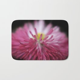 pink bellis on black Bath Mat