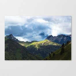 Sunlit field after storm Canvas Print