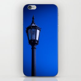 lamp over blue sky iPhone Skin