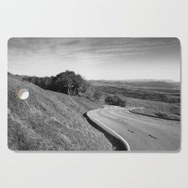 Winding road along the rolling hills near San Simeon, CA Cutting Board