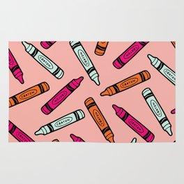 Crayons on Pink Pattern Rug