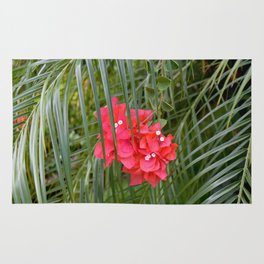 Tropical flower with palm tree branches Rug