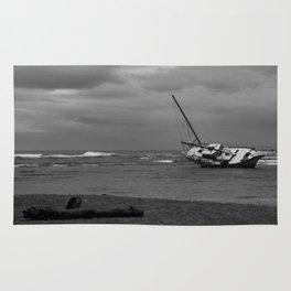 sunken boat Rug