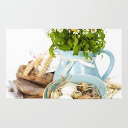 Food and wild flowers composition Rug